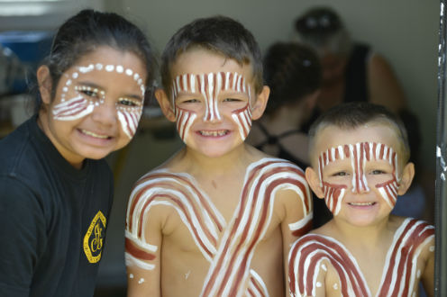 Children in traditional paint