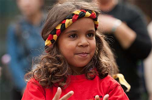 A young girl dancer with Aboriginal headband