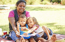 Aboriginal family reading a book