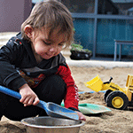 Child playing in the sand at an Aboriginal-led early years centre